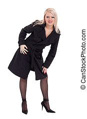 Full-length portrait of sexy young blonde woman in black...