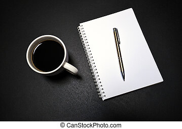 Blank notepad with office supplies and cup of coffee