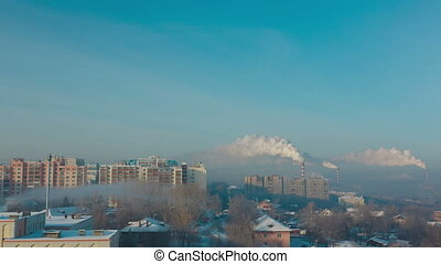 Smoke and fog over the city of Novosibirsk on a frosty sunny...