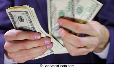 Businessman Counts Money in Hands. - Businessman counts...