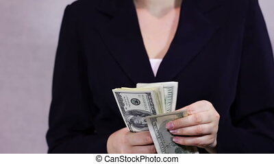 Business Women Counts Money in Hands - Business woman Counts...
