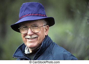 Dapper senior man in blue hat - Jaunty older man in blue hat...