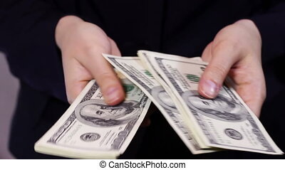 Businesswomen Counts Money in Hands. - Business woman Counts...