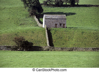 Stone building in English rural landscape