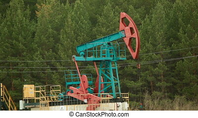 Oil Industry Pumpjack in forest - Oil Industry Pump jacks in...
