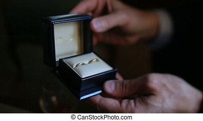 Grooms Hands Holding Box With Wedding Rings