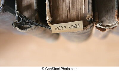 Hello world concept - Hello world text, handwritten on paper...