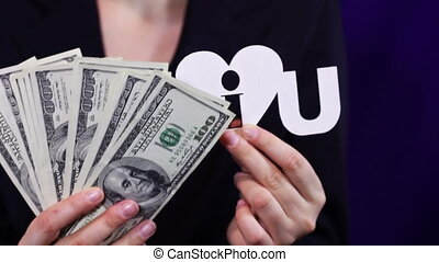 Business Woman Loves Money. - Business woman holding a few...