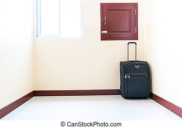 Luggage trolley was placed in the corner of the room.