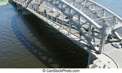 Quadrocopter shoot bridge with traffic and river in summer day. Slow motion