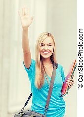 student with folders - picture of smiling student with...