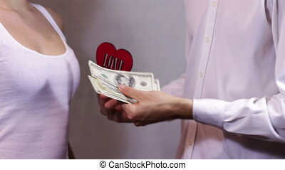 Love for Money. - Man offers the girl his love, and it shows...