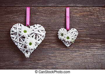 White hearts on old wooden background