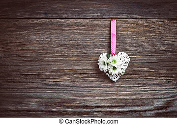 White heart on old wooden background