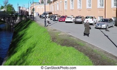 Quadrocopter shoot street with people in summer sunny day....
