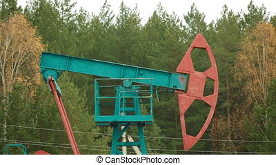 Oil Industry Pumpjack in forest Russia