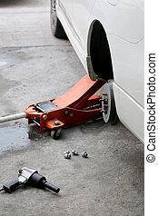Repairing wheel on vehicle.
