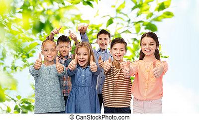happy children showing thumbs up - childhood, summer,...