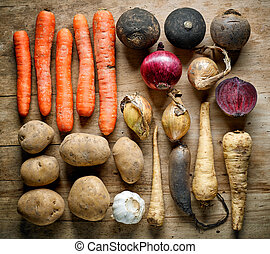 Various root vegetables on wooden table, top view, flat lay