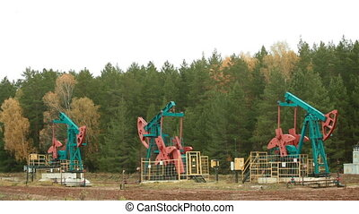 Oil Industry Pump jacks in forest - Oil Industry Pump jacks...