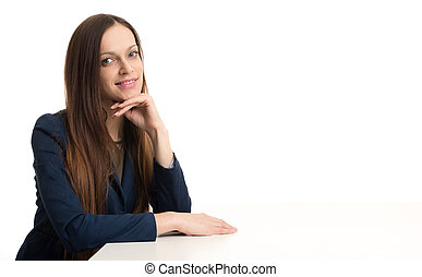 Beautiful young woman sitting at desk