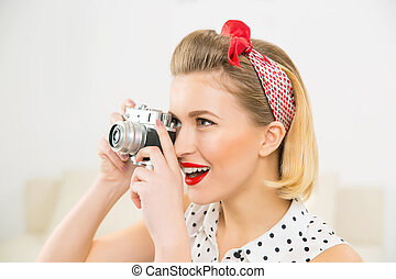Young attractive woman is taking a photo picture - Taking a...