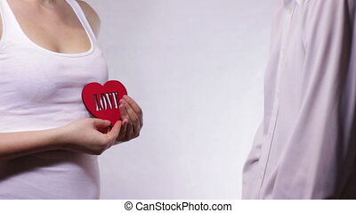 Woman Gives Love a Man - Man gives a red love heart girl on...