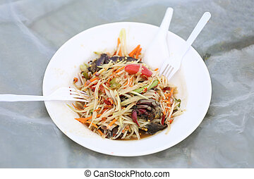 Papaya salad Som Tum in dish - Papaya salad Som Tum in...