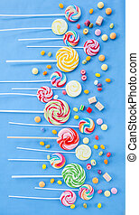 Colorful popsicles - Variety of colorful popsicles on blue...