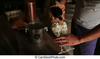 Sommelier Hand Pouring Rose Wine Into Glasses - Sommelier...