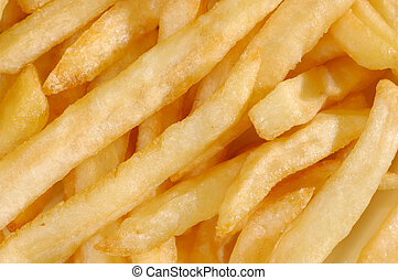 French Fries - French fried potatoes abstract texture macro...