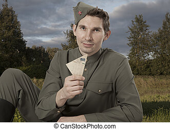 Portrait of Soviet soldier with a letter