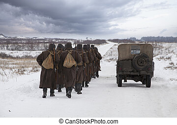 Soviet soldiers in a winter field - A company of Soviet...