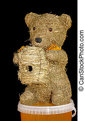 Honey Bear - Decorative straw bear with hive sitting on...