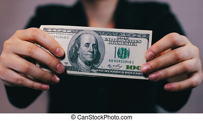Businesswomen Counts Money in Hands - Business woman Counts...