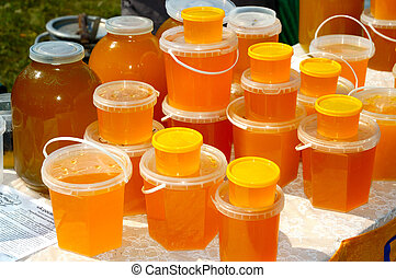 Honey Stall - Jars with amber-coloured fresh honey