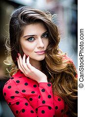 Beautiful brunette young woman wearing dress and walking on...