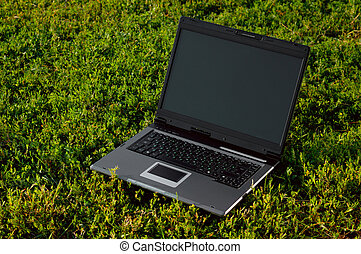 High-end Laptop On Grass - Laptop computer on grass