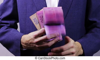 Businessman with Wads of Money in Hands.