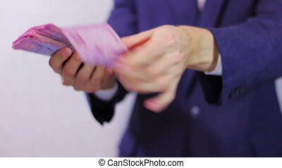 Businessman Counts Money in Hands. - Businessman counts tens...