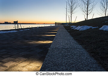 Boston Harborwalk near sunrise - Pre-dawn winter scene along...
