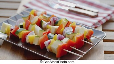 Colorful healthy fresh vegetable shish kebabs made with...