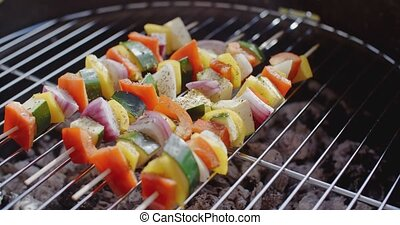 Four vegetable kabobs on grill - Four vegetable kabobs of...