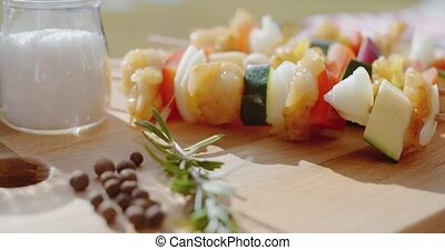 Four vegetable kabobs on cutting board - Four vegetable...