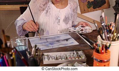 Woman drawing with watercolors - Caucasian woman artist...