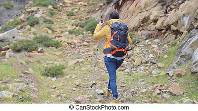 Rear view of an active female hiker