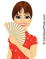 Chinese model in traditional Cheongsam dress holding a fan