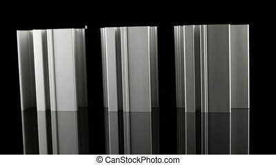 Aluminium profile sample isolated on black background