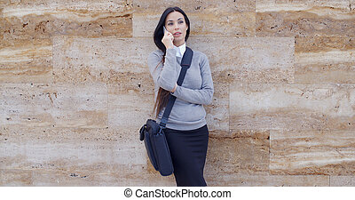 Woman using phone and waiting on hold - Serious young...