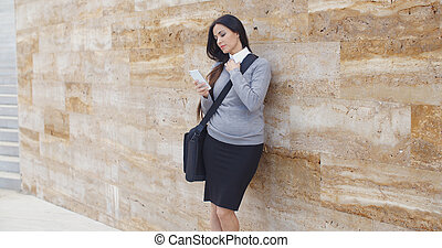 Serious woman checking email on phone outdoors - Serious...